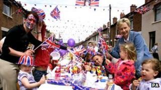 Locals celebrate Queen Elizabeth II's Golden Jubilee at a street party in south Belfast