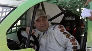 Turkish President Gurbanguli Berdymukhamedov at the wheel of his Turkish-made Volkicar in Ashgabat, 7 April