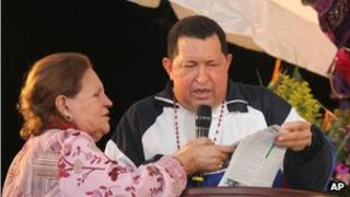 Hugo Chavez and his mother at a mass in Barinas