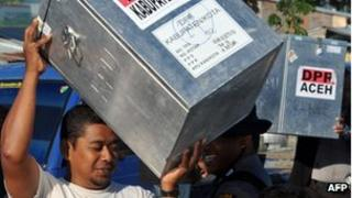 Men carry ballot boxes during distribution one day ahead of the province's second election in Aceh, Indonesia on 8 April, 2012