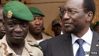 Mali's coup leader Capt Sanogo (L) and parliamentary speaker, Dioncounda Traore (R)