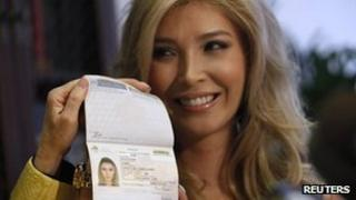 Jenna Talackova poses with her passport listing her as a woman on 3 April 2012