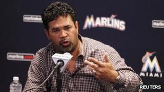Ozzie Guillen speaks at a news conference in Miami, Florida (April 10, 2012)