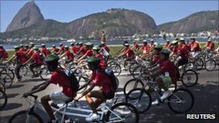 Cyclists in Rio de Janeiro with the sugar-loaf mountain in the background