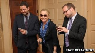 Adam Smith and Stacy Lambe with Mrs Clinton at the State Department