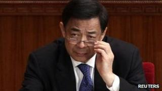 Bo Xilai adjusts his glasses during the opening ceremony of the Chinese People's Political Consultative Conference (CPPCC) in Beijing, 3 March 2012