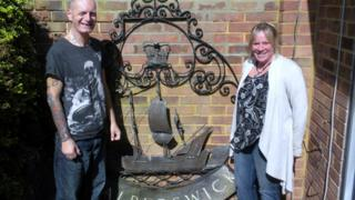 Philip and Lea Newstead with the Walberswick village sign