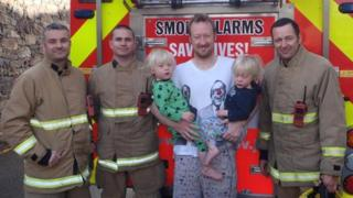 Alfie, Dylan and Matthew Winpenny with the firefighters who helped free them