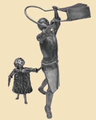 Sculpture of mill worker