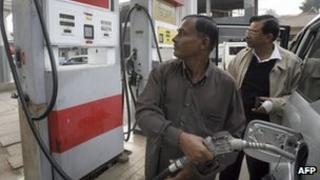 Consumers at a petrol pump in Bangladesh