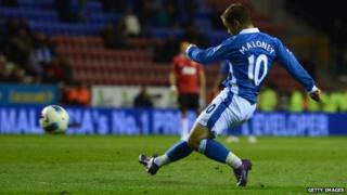 Shaun Maloney of Wigan scores to make it 1-0