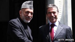 President Karzai (left) with Nato Secretary General Anders Fogh Rasmussen