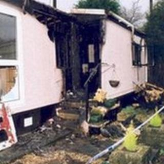 Aftermath of arson attack on mobile home in The Glen