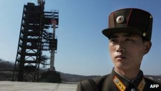 A soldier guards the Unha-3 rocket at North Korea's Tangachai-ri space centre, 8 April