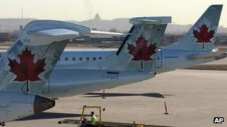 Air Canada planes sit on the tarmac of Pierre Trudeau airport in Montreal, Canada 23 March 2012