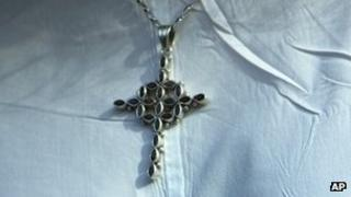 Cross worn around the neck