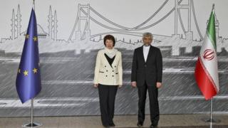 Iran's Chief Nuclear Negotiator Saeed Jalili, right, and EU Foreign Policy Chief Catherine Ashton pose for cameras before their meeting in Istanbul, Turkey, 14 April 2012