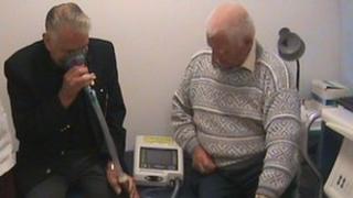 Patient Bill Tatnall (L) using the machine