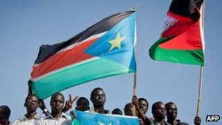 Protesters in Juba wave the flags of South Sudan and the SPLA with regard to the dispute over Heglig - 13 April 2012