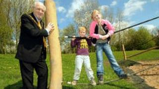 Councillor Chris Jackson and children at the new playground at Shipley Country Park