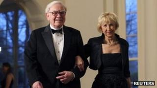 Warren Buffett and his wife attend a White House dinner for Prime Minister David Cameron 15 March 2012
