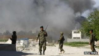 Afghan National army soldiers at the site of an attack, April 15 2012