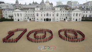 """260 Guardsmen from the Grenadier, Coldstream, Scots and Welsh Guards forming a giant """"100"""" at Horse Guards Parade in London to mark 100 days to go until the 2012 London Olympic Games"""