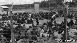 Suspected Mau Mau rebels held in a prison camp