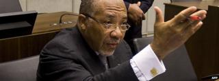 Former Liberian President Charles Taylor (L) waits on 8 February 2011 for the start of the prosecution's closing arguments during his trial at the UN Special Court for Sierra Leone