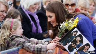 Duchess of Cambridge speaks with a girl in the crowd during a visit to The Treehouse in Ipswich on March 19, 2012
