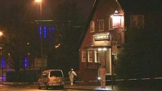 Forensics officers outside the Broadway Inn in Salford