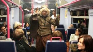 Two Gents Productions performers on train