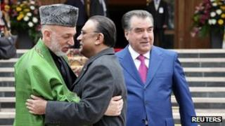 Tajikistan's President Imomali Rakhmon watches as President Karzai of Afghanistan embraces Pakistan's President Zardari (March 20102)
