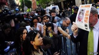 NYPD spokesman Paul Browne holds up a photo of Etan Patz 19 April 2012