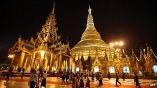 Visitors walk round the Shwedagon pagoda