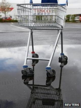 Tesco trolley in a puddle