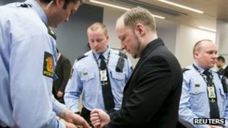 Defendant Anders Behring Breivik attends the fifth day of his trial in a courtroom in Oslo on Friday