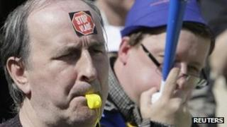 """Protesters with stickers """"Stop the government"""" blow whistles in Prague"""