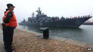 "In this photo released by China""s Xinhua News Agency, Russian Pacific Fleet""s flagship Varyag, a Slava-class guided missile cruiser, arrives at a naval base in Qingdao, east China""s Shandong Province, Saturday, April 21, 2012."