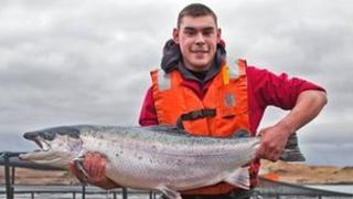 Farmer with a salmon