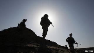 US soldiers on patrol with Afghan troops. 22 April 2012