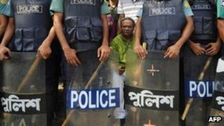 Bangladeshi police stand guard in front of the BNP's offices during a nationwide strike in Dhaka on Tuesday