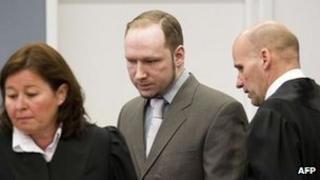 Anders Behring Breivik arriving in court with his lawyers
