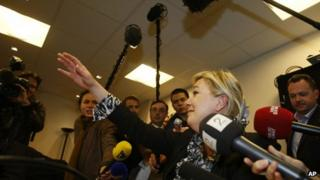 French National Front leader Marine Le Pen speaks to reporters in Nanterre, north-west of Paris, 23 April