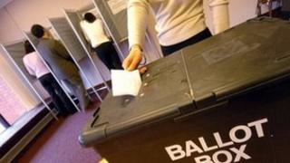 Vote being placed in a ballot box