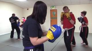 People training in boxing inside the sports centre