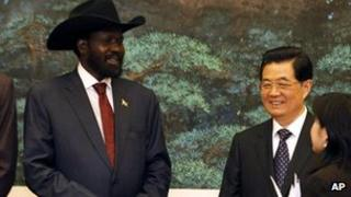 South Sudanese President Salva Kiir (left) and Chinese President Hu Jintao (right) talk during a signing ceremony at the Great Hall of the People in Beijing, 24 April 2012