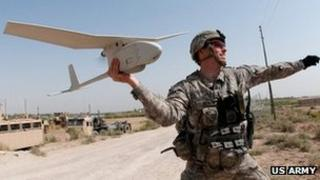 Army 1st Lt. Steven Rose launches an RQ-11 Raven unmanned aerial vehicle near a new highway bridge project along the Euphrates River north of Taqqadum, Iraq, Oct. 9, 2009