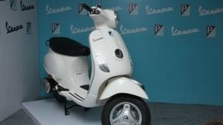 A white Piaggio Vespa LX125