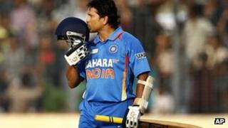 Sachin Tendulkar kisses his helmet after scoring his 100 century